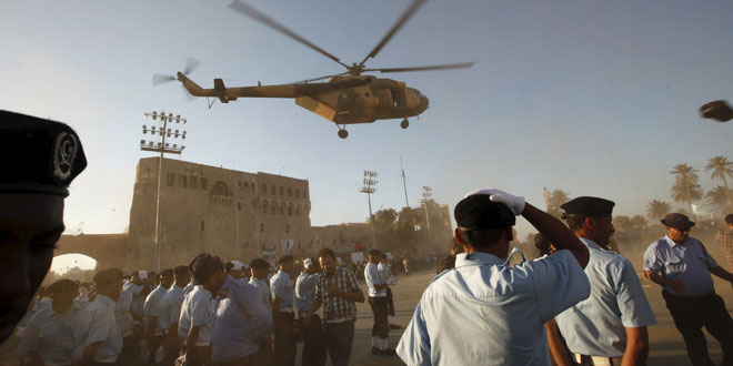 A helicopter flies past during a police graduation ceremony in Tripoli